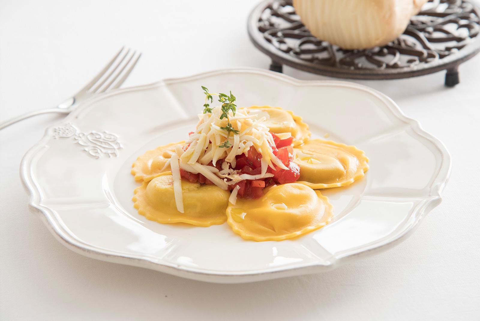 Ricetta Girasole Senza Glutine alla pizzaiola con cubettata di pomodorino aromatizzato al basilico, provola affumicata ed origano